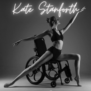 Kate in an arabesque position in her wheelchair in monotone.